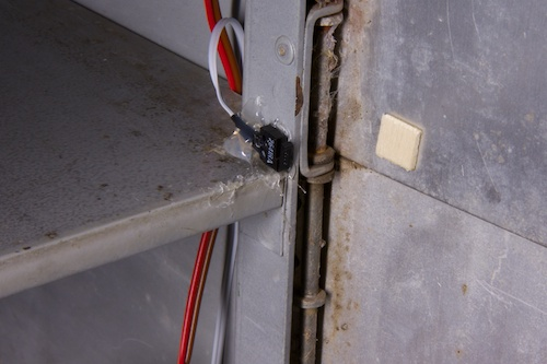 The contact switch used to detect the opening, simply glued
