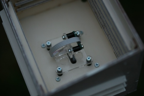 The sensor in its box, mounted vertically