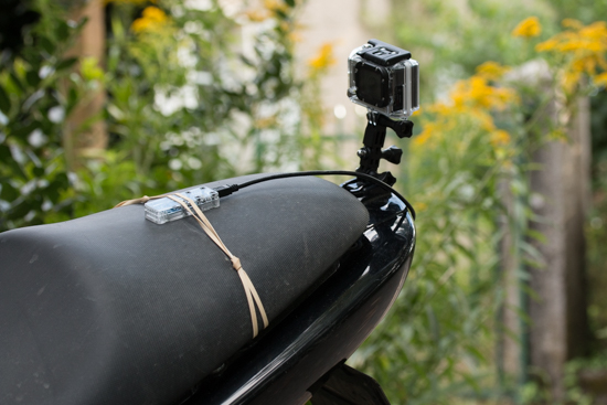 The GoPro, the Yocto-3D, and the battery assembled on the motorbike saddle spoiler
