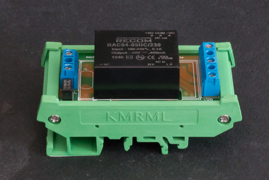 The power supply is composed of a RAC04-05DC/230 module and of a RAC-DIN-Rail mounting board, both from Recom