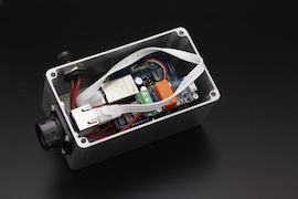 The electronics, fitting tightly in the enclosure